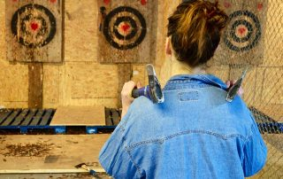 Black Axe Throwing Over shoulder